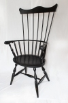 Comb back windsor chair with whale carvings