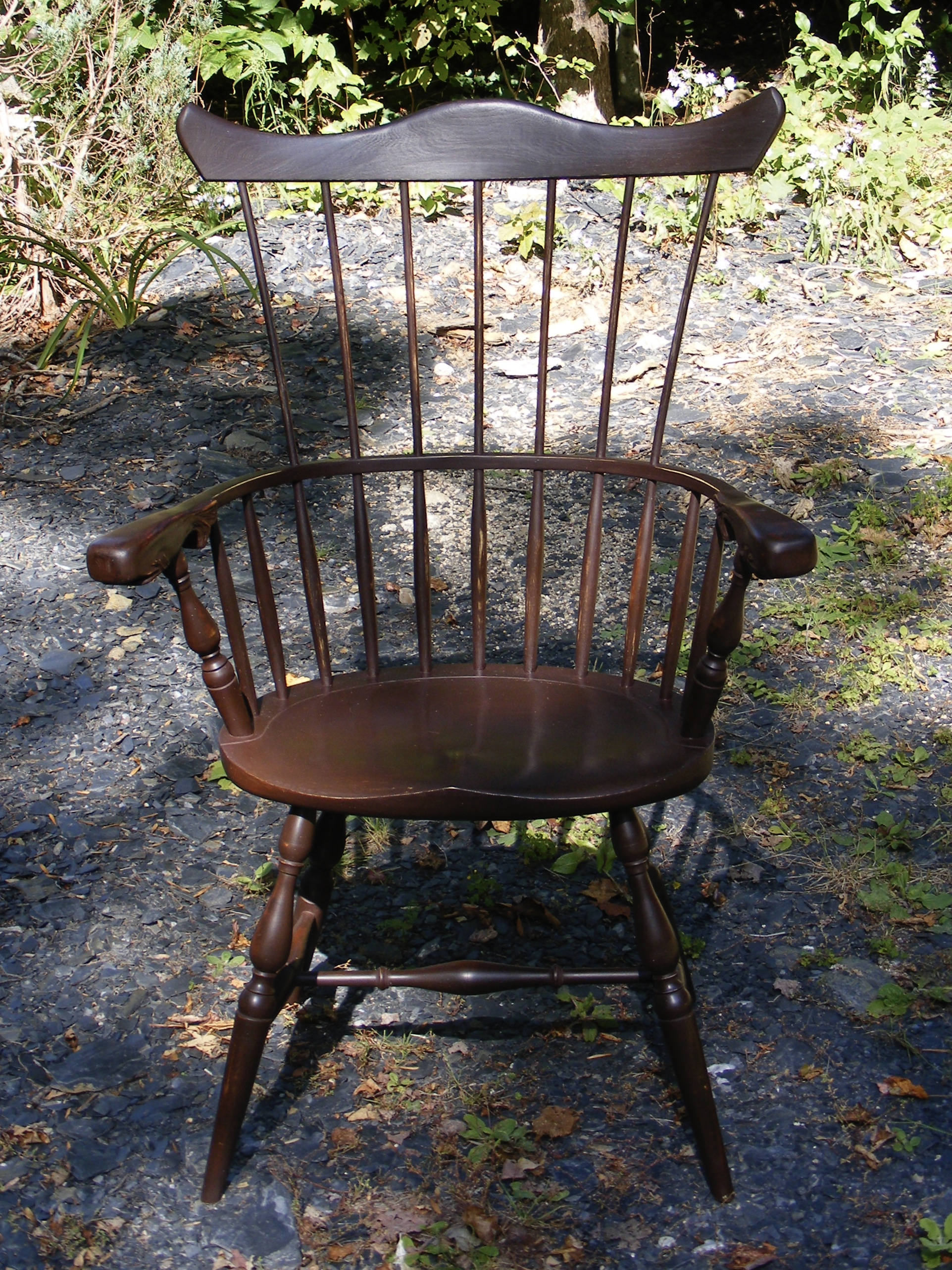 Comb back windsor chair with carved whale knuckles
