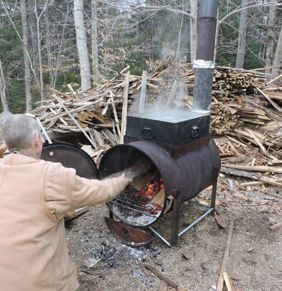 Evaporating maple sap on a burner made from a metal barrel.