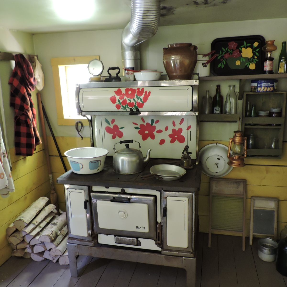 Folk art on the cook stove in Maud Lewis house